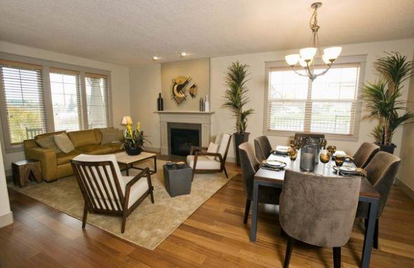 A decoração de sala de estar e sala de jantar conjugadas pode seguir duas vertentes diferentes: uni-las ainda mais ou separá-las inteiramente (Foto: Divulgação)
