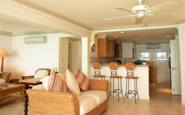 A decoração para sala de estar junto com a cozinha deve integrar ainda mais os ambientes, mas de forma harmoniosa e suave (Foto: Divulgação)