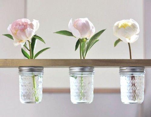 Invista em pelo menos uma das muitas ideias de decoração com potes de vidro (Foto: shelterness.com)