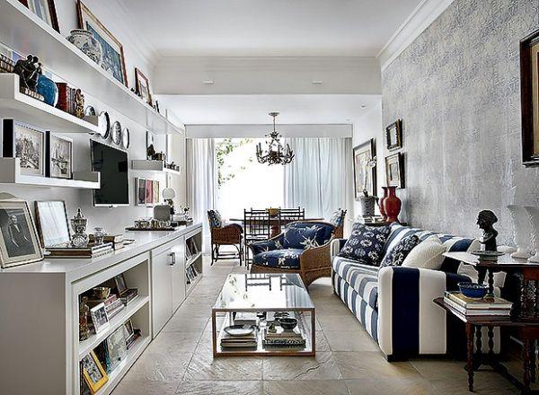 Usar porta-retratos na decoração pode valorizá-la instantaneamente (Foto: revistacasaejardim.globo.com)