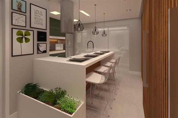 cozinha gourmet branca com quadros
