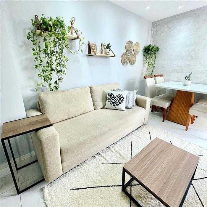 sala com dois ambientes com sofá
